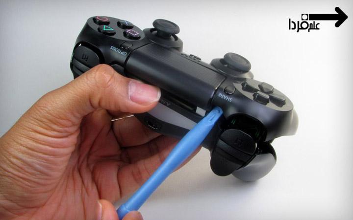 تعویض باتری دسته PS4 - باز کردن قاب جلو